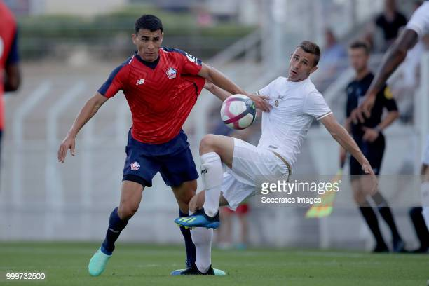 Junior Alonso Mujica of Lille Remi Oudin of Reims during the Club Friendly match between Lille v Reims at the Stade Paul Debresie on July 14 2018 in...