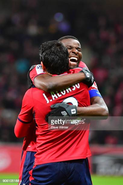 Junior Alonso of Lille is congratulated by Ibrahim Amadou of Lille after putting their side 10 ahead during the Ligue 1 match between Lille OSC and...