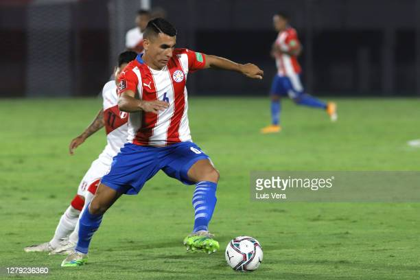 Junior Alonso of Paraguay drives the ball during a match between Paraguay and Peru as part of South American Qualifiers for Qatar 2022 at Estadio...