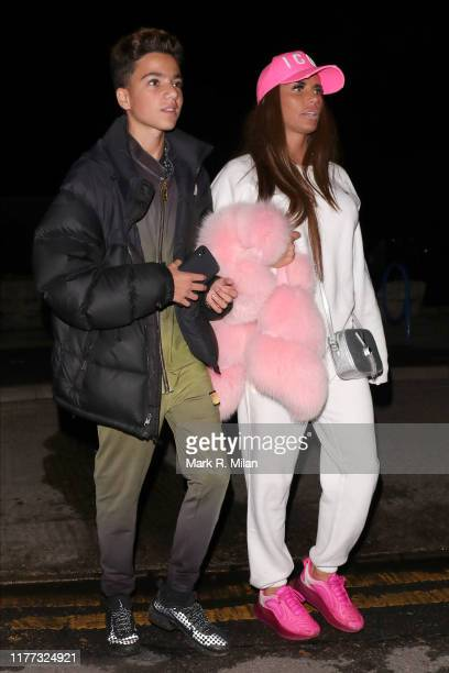 Junior Andre and Katie Price leaving Thorpe Park Fright Night on September 26, 2019 in London, England.