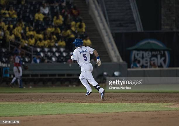 Junior Arrojo rounds the bases after hitting a home run against the Cuban National Team at Palisades Credit Union Park on June 24, 2016 in Pomona,...