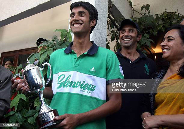 Junior Australian Open Tennis Champion Yuki Bhambri with mother Indu Bhambri and coach as he comes out of his residence to talk to media and shows...