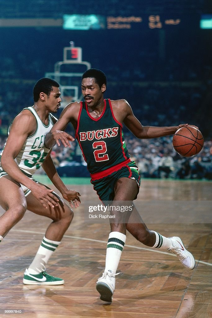 Junior Bridgeman #2 of the Milwaukee Bucks drives to the basket against Charles Bradley #35 of the Boston Celtics during a game played in 1983 at the Boston Garden in Boston, Massachusetts.