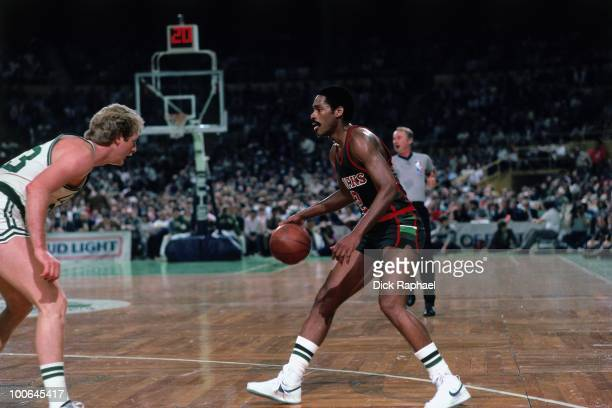 Junior Bridgeman of the Milwaukee Bucks looks to make a move against Larry Bird of the Boston Celtics during a game played in 1984 at the Boston...