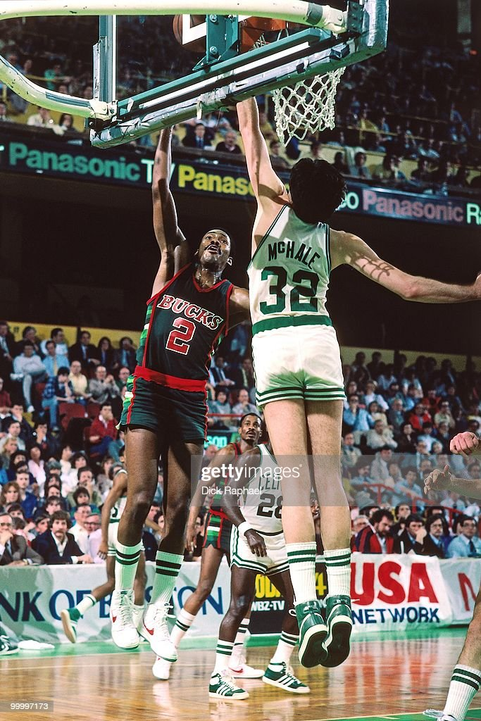 Junior Bridgeman #2 of the Milwaukee Bucks shoots a layup against Kevin McHale #32 of the Boston Celtics during a game played in 1983 at the Boston Garden in Boston, Massachusetts.
