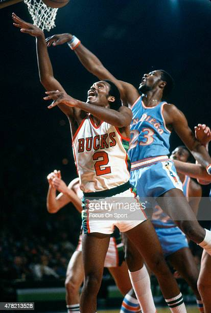 Junior Bridgeman of the Milwaulkee Bucks has his shot blocked by Joe Bryant of the San Diego Clippers during an NBA basketball game circa 1980 at the...