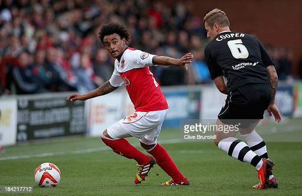 Junior Brown of Fleetwood Town moves away from Liam Cooper of Chesterfield during the Sky Bet League Two match between Fleetwood Town and...