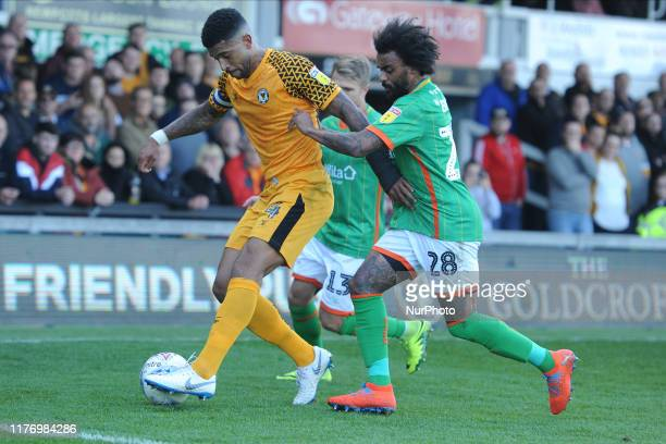 Junior Brown of Scunthorpe United and Robbie Willmott of Newport during of Newport during the Sky Bet League Two match between Newport County and...