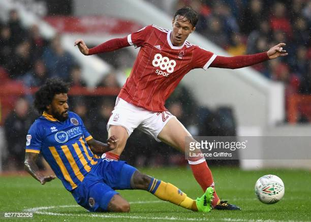 Junior Brown of Shrewsbury tackles Kieran Dowell of Nottingham Forest during the Carabao Cup First Round match between Nottingham Forest and...