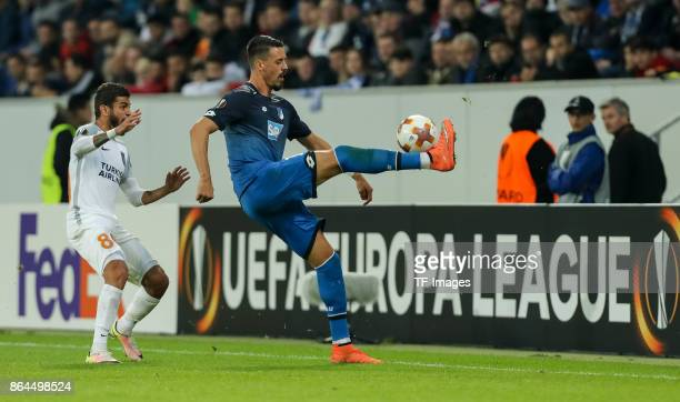 Junior Caicara of Istanbul Basaksehir and Sandro Wagner of Hoffenheim battle for the ball during the UEFA Europa League Group C match between 1899...