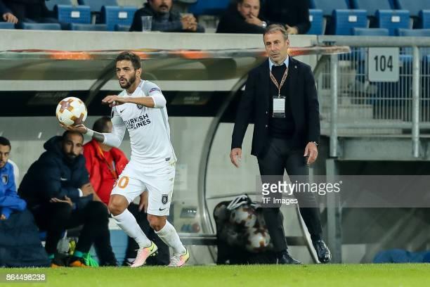 Junior Caicara of Istanbul Basaksehir controls the ball Head coach Abdullah Avci of Istanbul Basaksehir looks on during the UEFA Europa League Group...