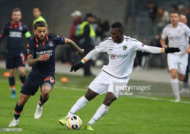 November 07: Junior Caicara of Istanbul Basaksehir F.K. And Anderson Niangbo of Wolfsberger AC during the UEFA Europa League match between...