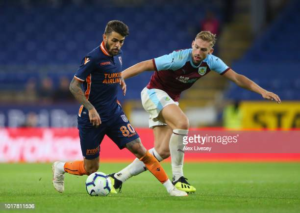 Junior Caicara of Istanbul Basaksehir is challenged by Charlie Taylor of Burnley during the UEFA Europa League third round qualifier second leg...