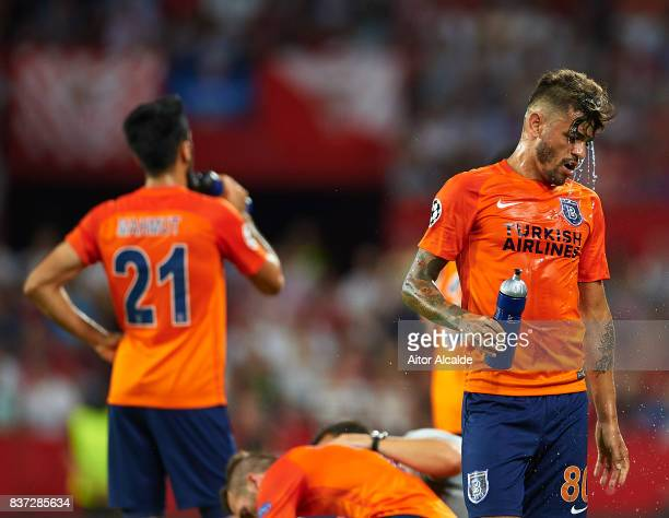Junior Caicara of Istanbul Basaksehir takes some water during the UEFA Champions League Qualifying Play-Offs round second leg match between Sevilla...