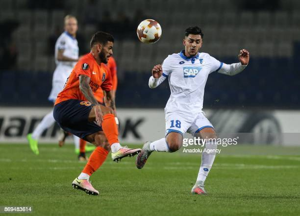 Junior Caicara of Medipol Basaksehir in action against Nadiem Amiri of Hoffenheim during the UEFA Europa League Group C soccer match between Medipol...