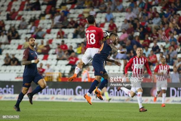 Junior Caicara of Medipol Basaksehir in action against Yekta Kurulus of Antalyaspor during the Turkish Super Lig match between Antalyaspor and...