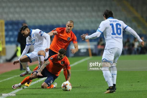 Junior Caicara of Medipol Basaksehir vies for the ball against Nadiem Amiri during the UEFA Europa League Group C soccer match between Medipol...