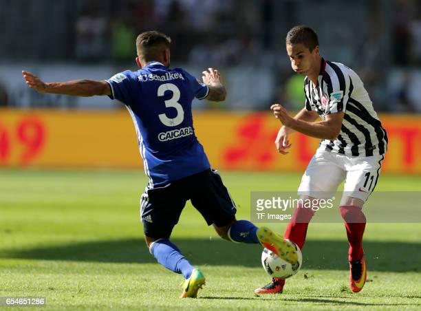 Junior Caicara of Schalke and Mijat Gacinovic of Frankfurt battle for the ball during the Bundesliga match between Eintracht Frankfurt and FC Schalke...