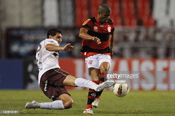 Junior Cesar of Flamengo struggles for the ball with a player of Lanus during a match between Flamengo and Lanus as part of the Copa Libertadores...