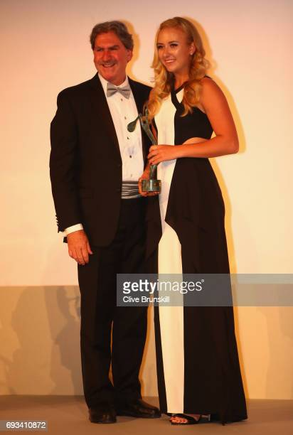 Junior Champion Anastasia Potapova collects her award from ITF Chairman David Haggerty after day ten of the 2017 French Open at Pavillon Cambon...