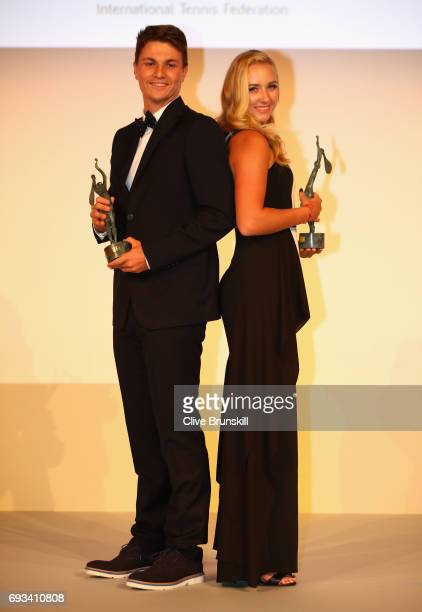 Junior Champions Anastasia Potapova of Russia and Miomir Kecmanovic of Serbia collect their awards after day ten of the 2017 French Open at Pavillon...