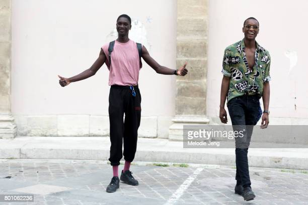 Junior Choi Oliver Kumbi outside the Thom Browne show on June 25 2017 in Paris France
