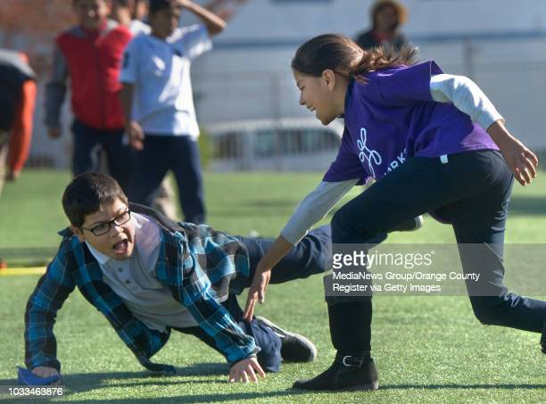 Junior coach Andrea Payan tags fourth grader Gabriel Robledo in a game that Playworks coach Ashley Cole calls 'hungry hungry hippos' during Garfield...