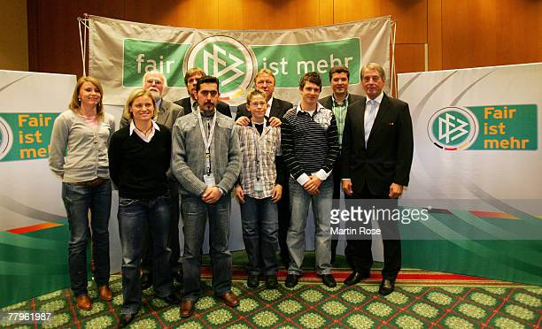 Junior coach of the DFB Horst Hrubesch and DFB vize president Rolf Hocke pose for a picture with the winners of the Fair Play trophy 2007 in...