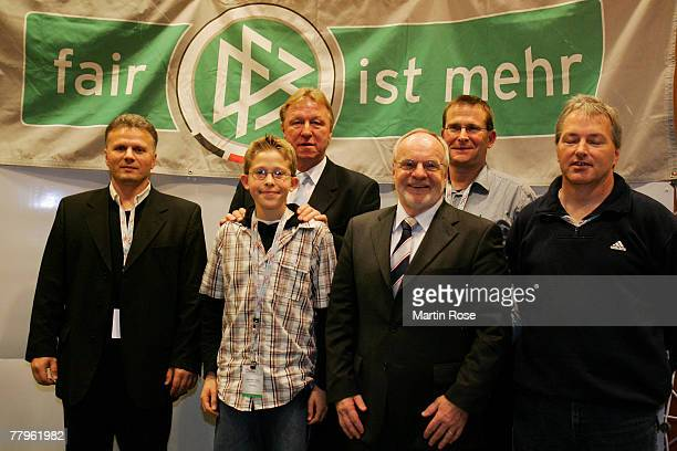 Junior coach of the DFB Horst Hrubesch poses for a picture with members of the Schleswig Holstein football association at the Fair Play trophy 2007...