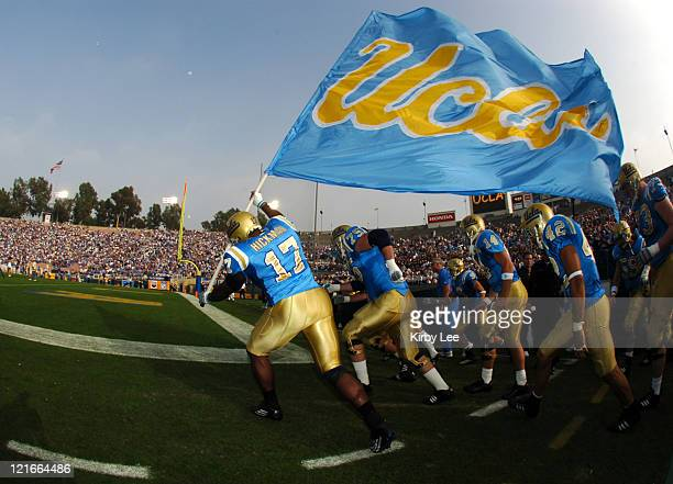 UCLA junior defensive end Justin Hickman and Bruin teammates run onto field with flag before 5128 victory over Oregon State in Pacific10 Conference...