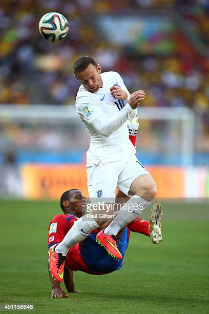 Junior Diaz of Costa Rica challenges Wayne Rooney of England during the 2014 FIFA World Cup Brazil Group D match between Costa Rica and England at...