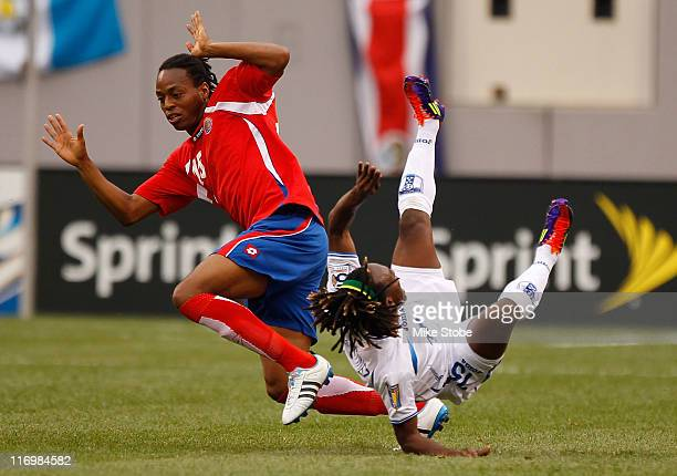 Junior Diaz of Costa Rica upends Walter Martinez of Honduras during the 2011 Gold Cup Quarterfinals on June 18 2011 at the New Meadowlands Stadium in...