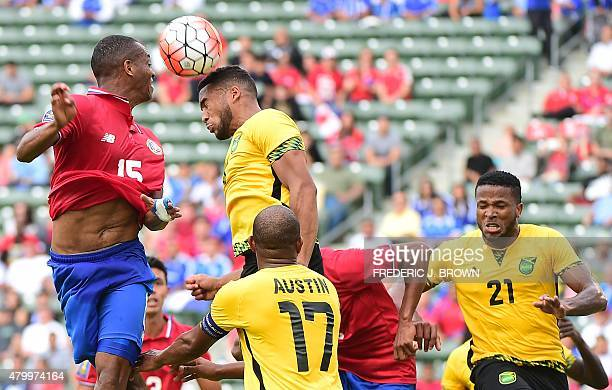 Junior Diaz of Costa Rica vies for the header with Adrian Mariappa of Jamaica during their 2015 Concacaf Gold Cup match in Carson California on July...