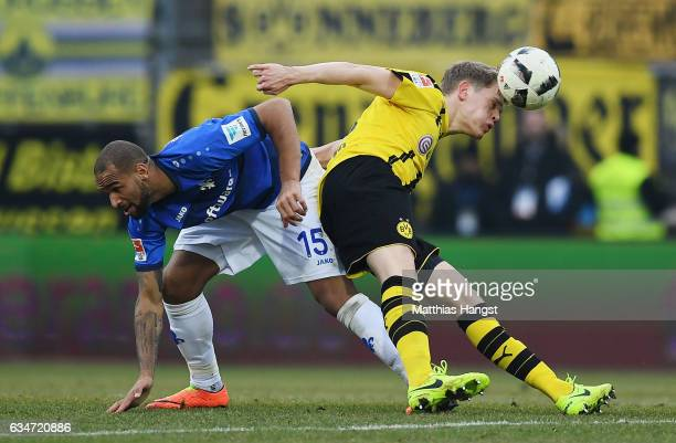Junior Diaz of Darmstadt and Matthias Ginter of Dortmund compete for the ball during the Bundesliga match between SV Darmstadt 98 and Borussia...