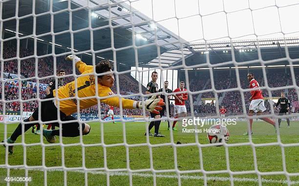 Junior Diaz of Mainz scores his team's first goal past goalkeeper Roman Buerki of Freiburg during the Bundesliga match between FSV Mainz 05 and SC...