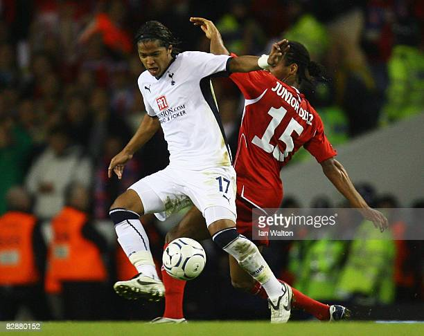 Junior Diaz of Wisla Krakow battles with Giovani dos Santos of Tottenham Hotspur during the UEFA Cup First Round First Leg match between Tottenham...