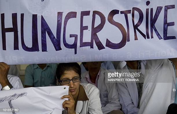 A junior doctor holds a placard during a protest at Safdarjung Hospital in New Delhi on June 1 2010 Over 500 junior doctors including postgraduate...
