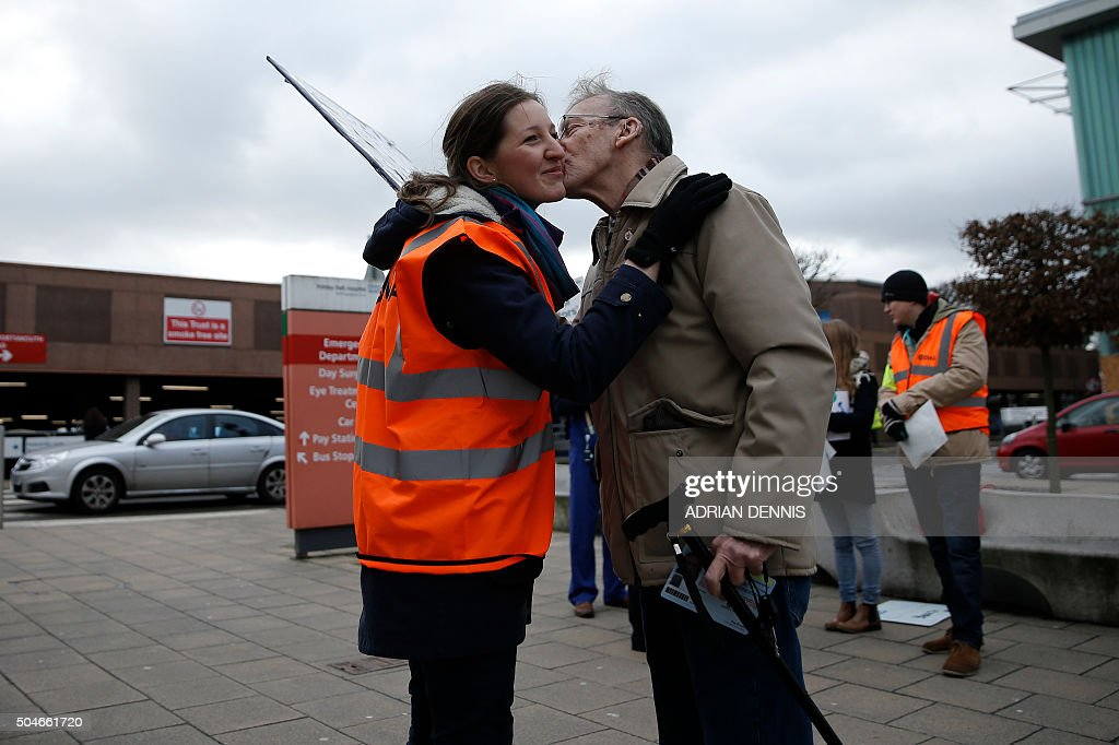 A junior doctor receives a kiss from a patient as he leaves Frimley Park Hospital in Frimley, south west of London, on January 12, 2016, during a strike by junior doctors. Tens of thousands of junior doctors in England went on strike Tuesday, causing major disruption to hospitals across the country in the first walkout of its kind for 40 years. The strike is over a new type of contract which the government says will improve healthcare at night and at weekends but medics say would drastically reduce their pay.
