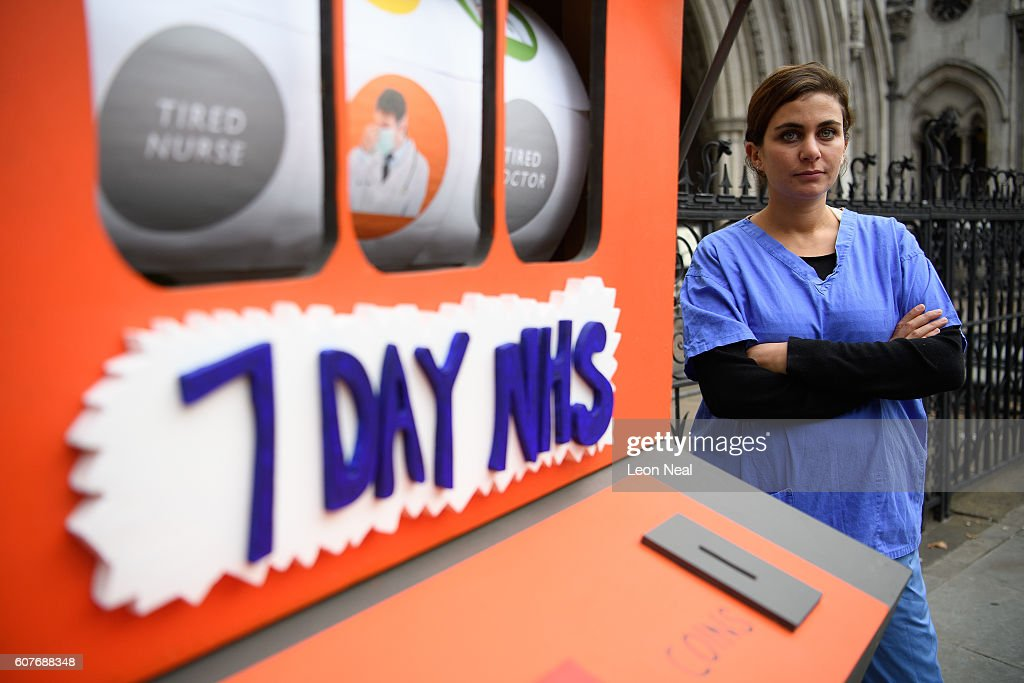 A junior doctor stands next to a fake slot machine as junior doctors and supporters rally outside the Royal Courts of Justice, Strand on the first day of their hearing as they challenge the government's plan for a seven-day NHS service, on September 19, 2016 in London, England. Justice for Health was founded in March 2015 by five frontline junior doctors to mount a legal challenge against the proposals by Jeremy Hunt, the Secretary of State for Health, to provide a full NHS service over the weekend, despite claims by opponents that the plan is under-funded and has not been fully considered.