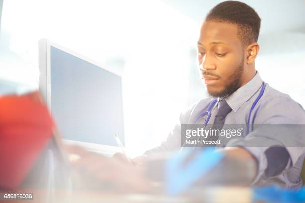 Junior doctor works at his desk