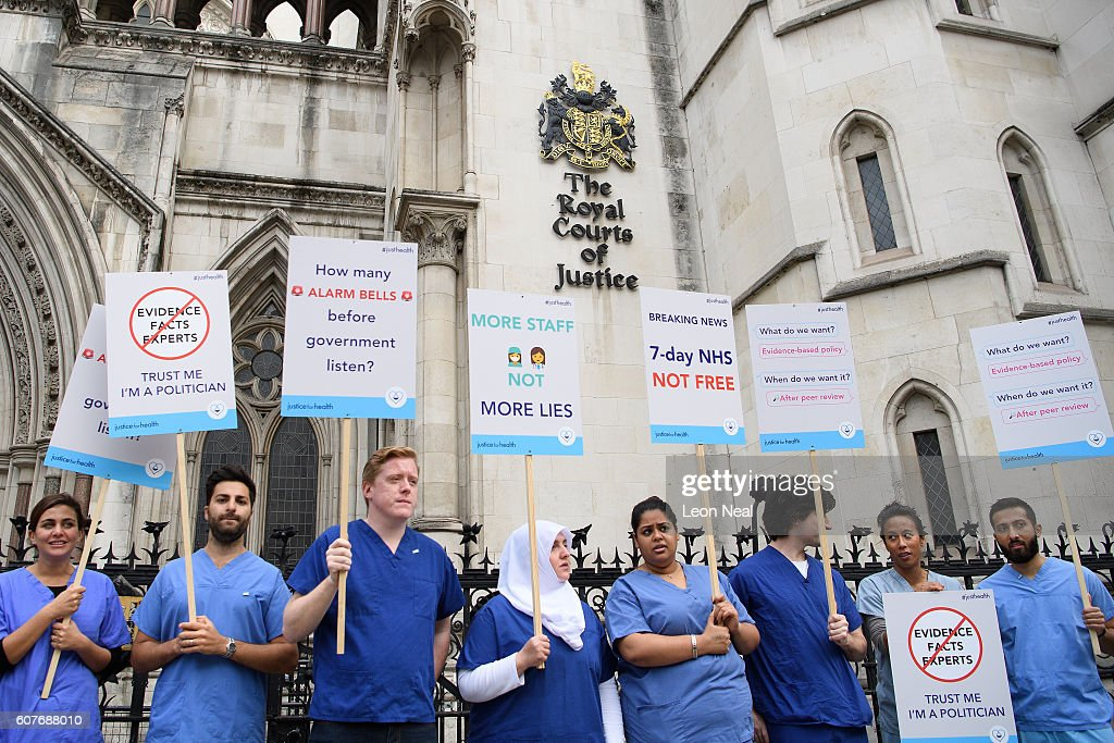 Junior doctors and supporters rally outside the Royal Courts of Justice, Strand on the first day of their hearing as they challenge the government's plan for a seven-day NHS service, on September 19, 2016 in London, England. Justice for Health was founded in March 2015 by five frontline junior doctors to mount a legal challenge against the proposals by Jeremy Hunt, the Secretary of State for Health, to provide a full NHS service over the weekend, despite claims by opponents that the plan is under-funded and has not been fully considered.
