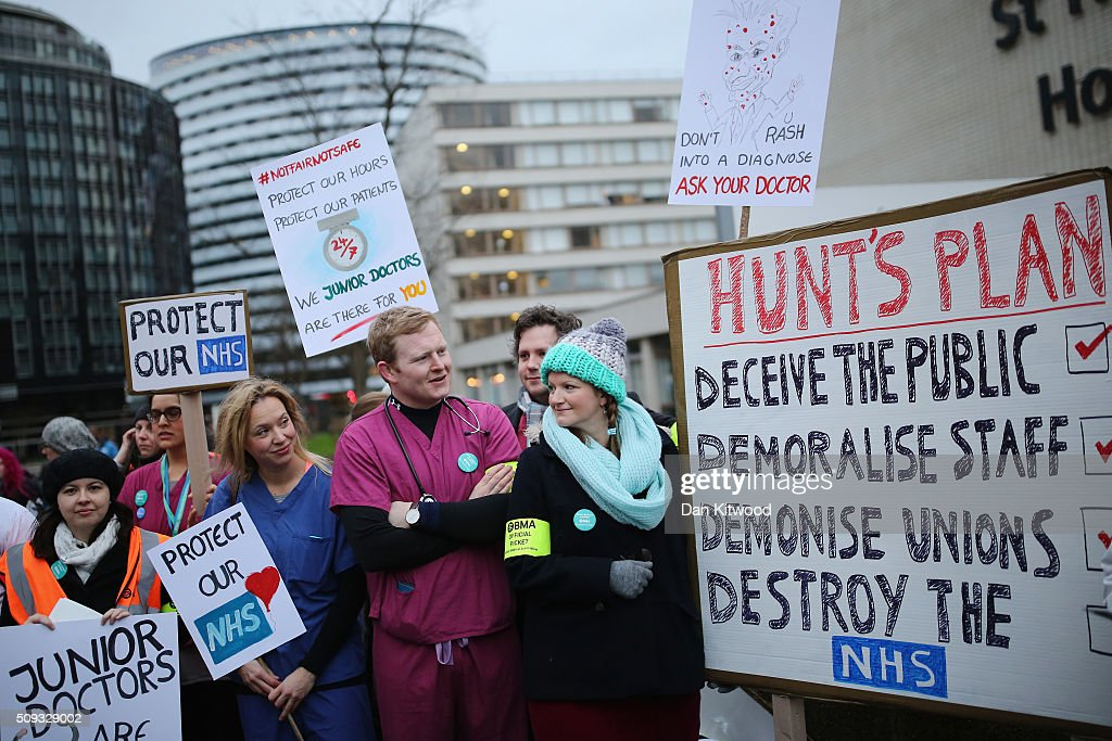 Junior Doctors carry placards on Westminster Bridge as they demonstrate outside St Thomas's Hospital on February 10, 2016, in London, England. Junior Doctors across the United Kingdom began a 24 hour strike today over the British governments' plans to change contracts for junior doctors. Doctors have claimed that Prime Minister David Cameron's government is not providing enough resources for the state-run National Health Service (NHS), which was founded by a socialist government in 1948 to provide free health care at the point of delivery.