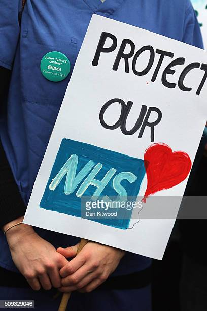 Junior Doctors carry placards on Westminster Bridge as they demonstrate outside St Thomas's Hospital on February 10 in London, England. Junior...