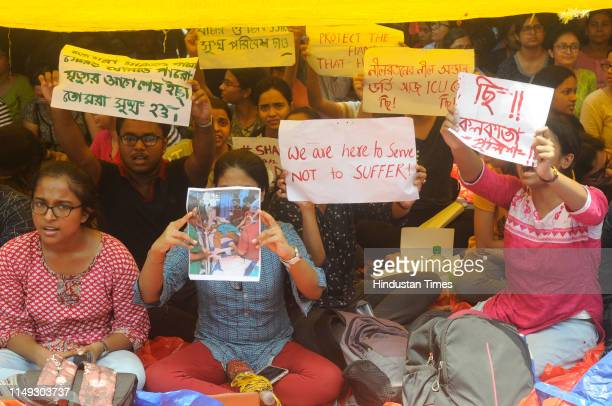 Junior doctors from Nil Ratan Sircar Medical College and Hospital continue a sit in protest inside the hospital campus that began on Monday after a...