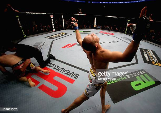 Junior dos Santos celebrates after punching to defeat Cain Velasquez by TKO in the first round of their Heavyweight Championship Title bout during...