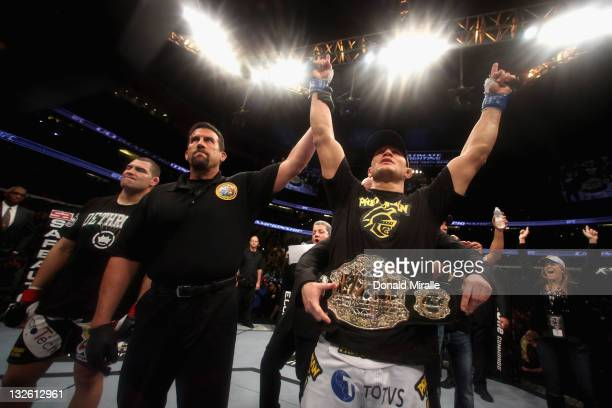 Junior dos Santos celebrates with the belt after defeating Cain Velasquez by TKO in the first round of their Heavyweight Championship Title bout...