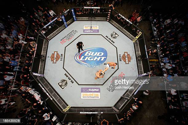 Junior Dos Santos kicks Cain Velasquez in their UFC heavyweight championship bout at the Toyota Center on October 19 2013 in Houston Texas Cain...