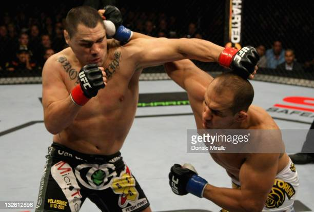 Junior dos Santos lands a punch to send Cain Velasquez down in the first round of their Heavyweight Championship Title bout during the UFC on FOX...
