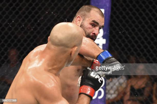 Junior Dos Santos of Brazil and Blagoy Ivanov exchange punches in their heavyweight fight during the UFC Fight Night event inside CenturyLink Arena...