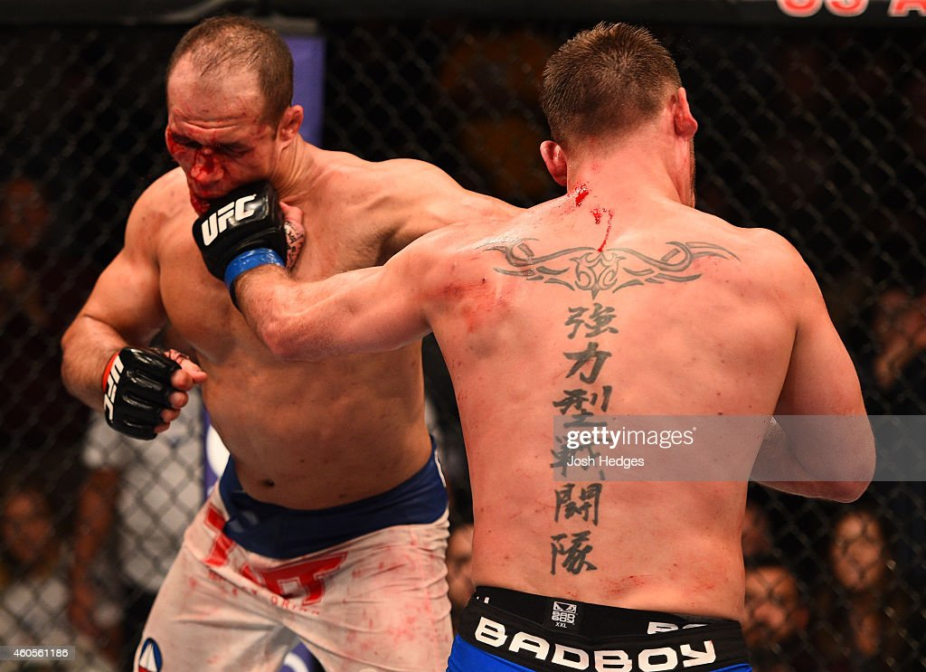 Junior Dos Santos of Brazil and Stipe Miocic trade punches in their heavyweight fight during the UFC Fight Night event at the U.S. Airways Center on December 13, 2014 in Phoenix, Arizona.